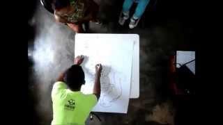 Elton desenhando a Cuca