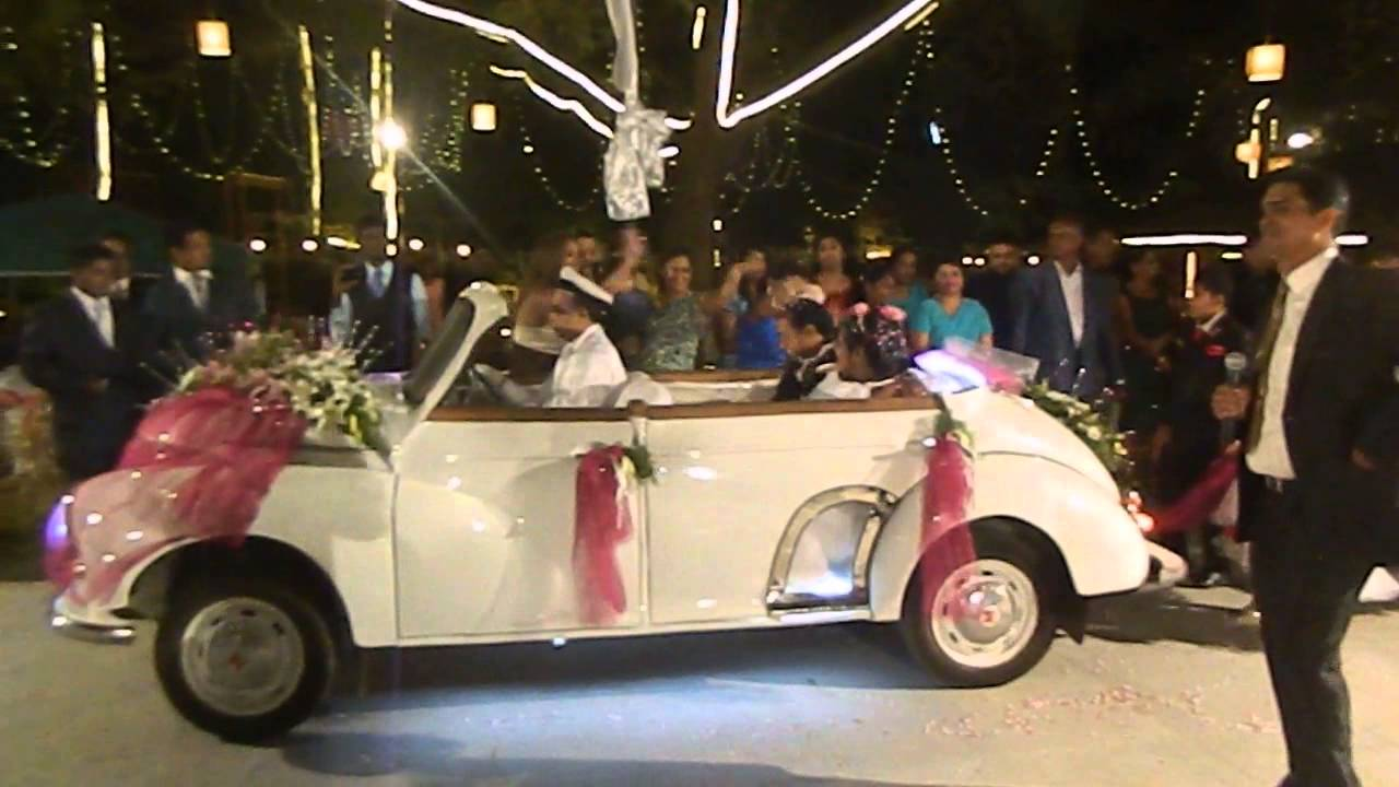 Goa Wedding MC Elias Fernandes guiding the bridal vintage car entry ...