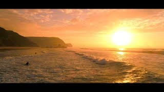 Sunset surfing at the cliffs, Sagres, Portugal
