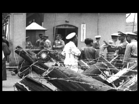 British and Shanghai Municipal police marshal forces to maintain order during unr...HD Stock Footage