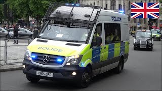 Police protected carrier van responding on siren and lights in London