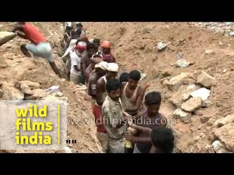 Workers lay underground cable in Delhi : archaic method for modern tech