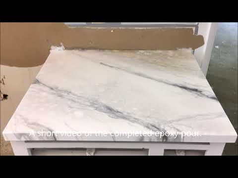 Faux white marble epoxy countertop with subway tile backsplash over old laminate countertop