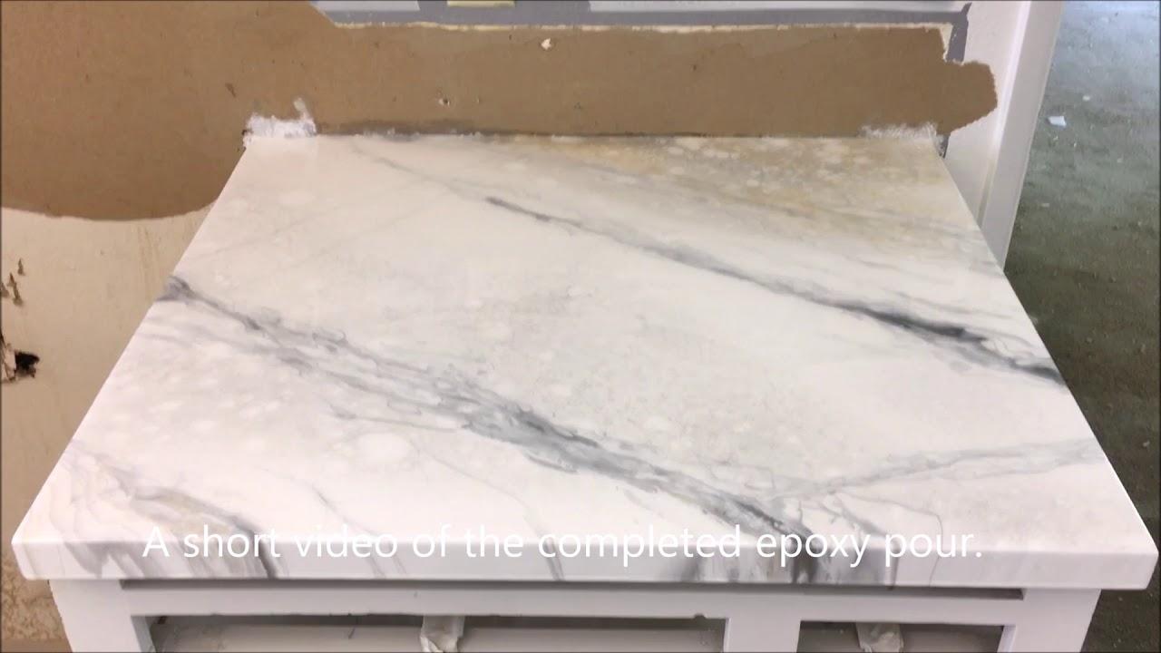 - Faux White Marble Epoxy Countertop With Subway Tile Backsplash