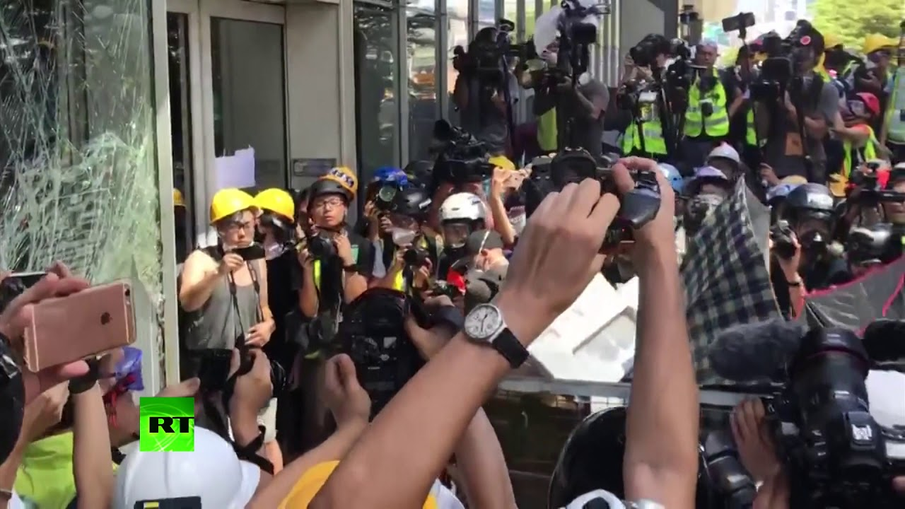 Hong Kong Protesters Batter Council Building Windows With Trolley