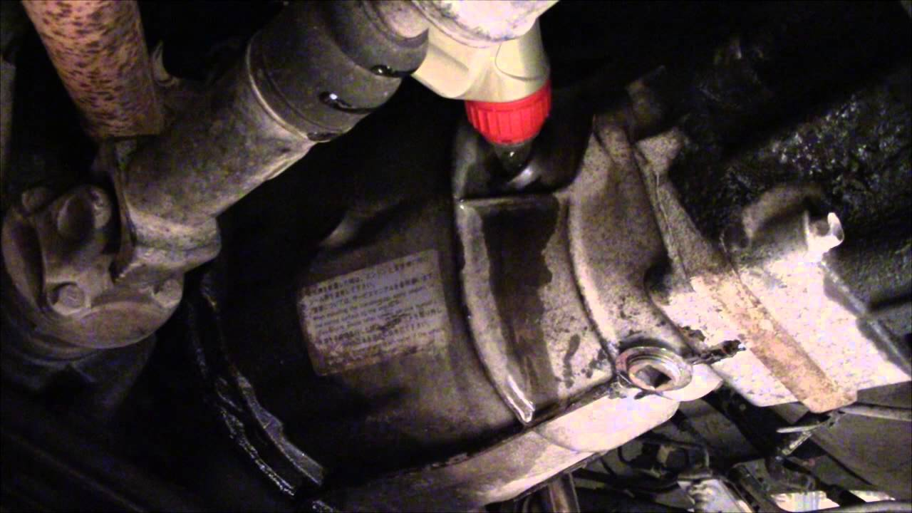 Changing gearbox fluid in my Nissan D21 - YouTube