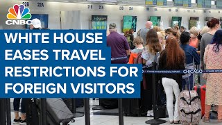 White House eases travel restrictions for foreign visitors