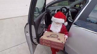 """Tiny"" Santa Delivers Pizza"