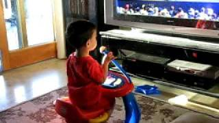 Toddler Rocking It Out On Little Tikes Piano & Drum Stool