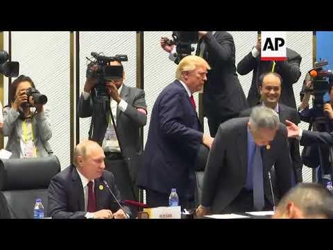 Trump and Putin shake hands ahead of Vietnam APEC meeting