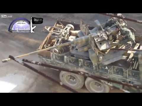 syrian rebels use a 57mm anti air gun to attack al kindi