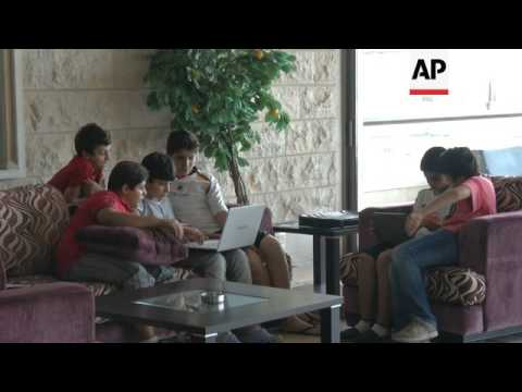 Thousands of Syrians fleeing fighting pack Lebanon's hotels, tourist areas