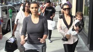 Kim Kardashian Walks Into A Paparazzi Frenzy [2013]