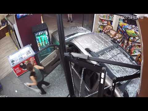 Frosty - Car in reverse crashes through front of  liquor store