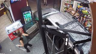 Graphic content: Car crashes through Muskegon Heights liquor store