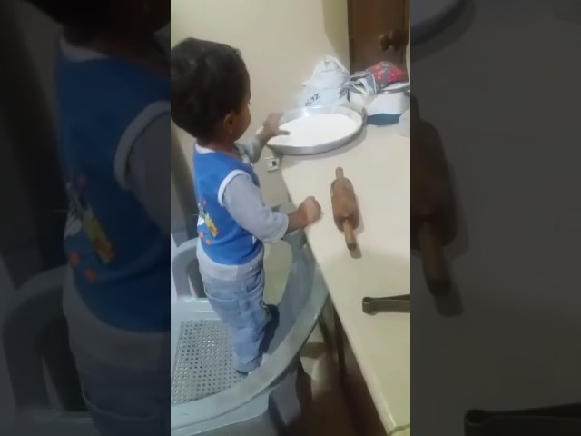 2 years old baby making roti..
