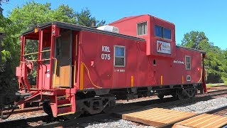 Little Red Caboose On The End Of CSX Freight Train