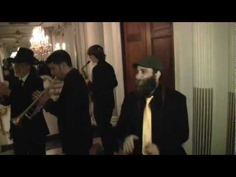 Jewish wedding music band Shir Soul escorts a newly married couple to the Yichud room