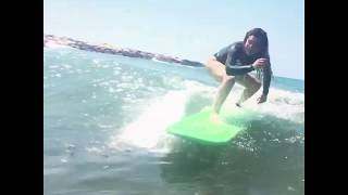 slow motion - First green wave on her own! - golesh surf school