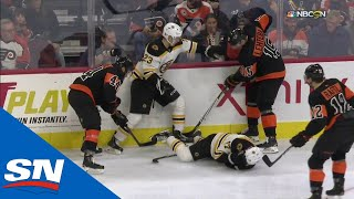Boston Bruins' Ryan Donato Bloodied After Hit From Behind Into Boards