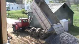 Mack Dumptruck dumping gravel