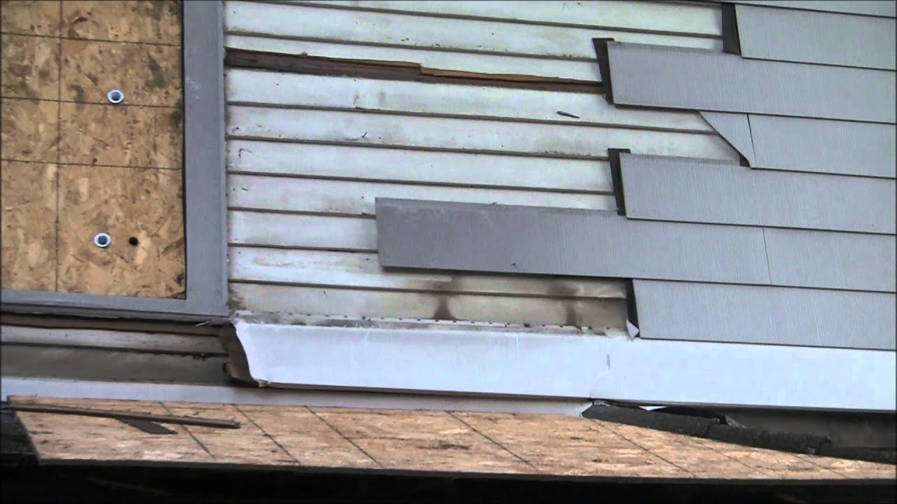 Removing Old Asbestos Clapboard Siding By Duct Taping A