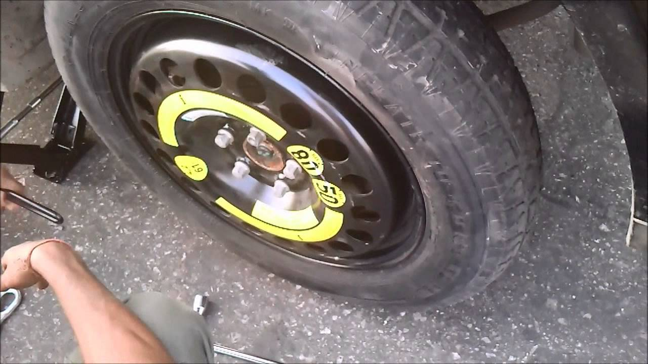 Changing tyre of ml350 cdi with the spare jimmy youtube for Mercedes benz flat tire