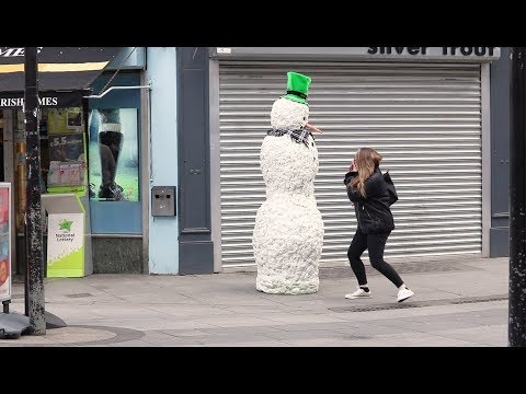 Woman terrified by snowman