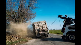 Village Towing rights tipped beet truck near Linwood