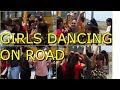 GIRLS DANCING ON ROAD