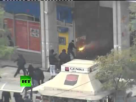 Action video of Greece riots as fire bombs, stones fly in Athens