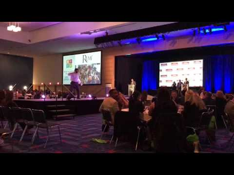 Remi Accepts Best Places to Work Award 2016
