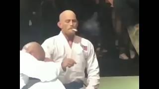 Jeff Glover & his opponent smoking weed as referee Eddie Bravo watches before HIGH ROLLERZ BJJ