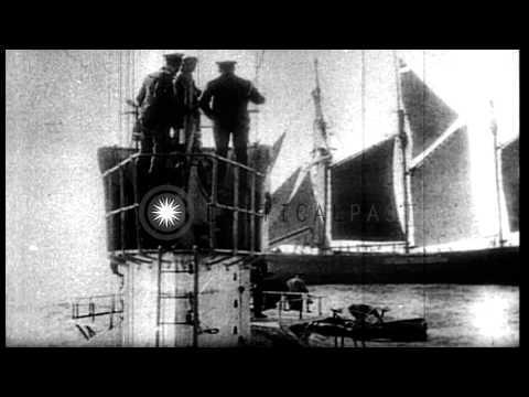 A German U- Boat sinks a three-masted schooner at sea during World War I HD Stock Footage