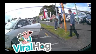 Woman Falls from Car After Minor Accident || ViralHog