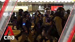 Hong Kong riot police arrest dozens as protesters disrupt traffic on major roads