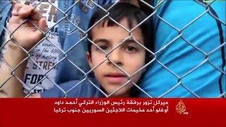 ميركل وأوغلو يزوران مخيما للاجئين السوريين جنوبي تركيا