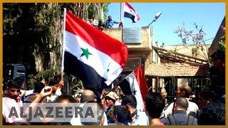 🇸🇾 Syria's Deraa: Regime raises flag in cradle of protest movement | Al Jazeera English