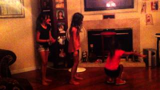 Three crazy girls dancing the cha cha slide!