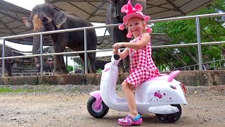 Funny Baby Stacy playing at the zoo and feeds animals Video for kids