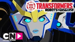 Transformers: Robots in Disguise | Strongarms Big Score | Cartoon Network