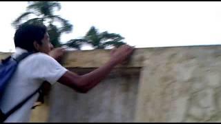 Jamil climbing the wall of Barisal govt girls high school,Bangladesh.