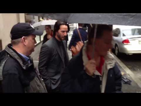 Actor Keanu Reeves posing with fans outside Today Show in New York