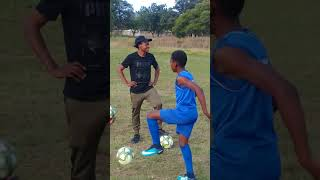 Unsefish Percy Tau teaching younsters in his home town