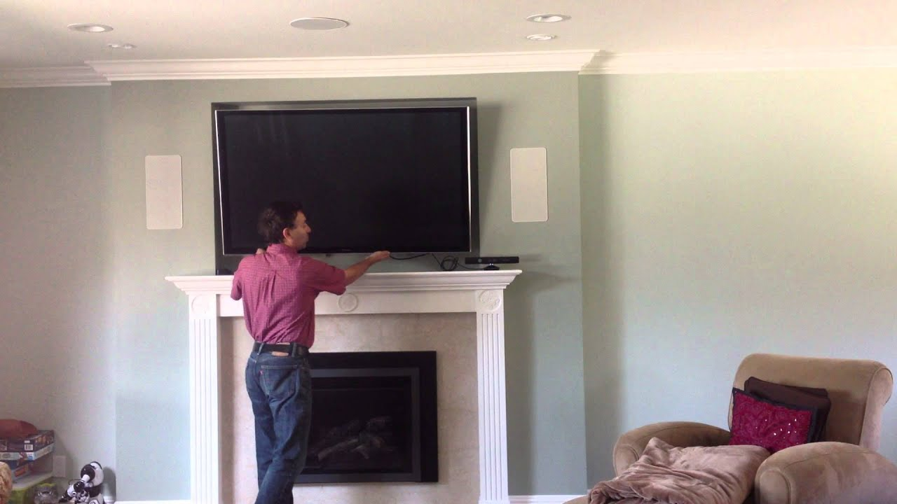 TV over fireplace using Down and Out Mount - YouTube