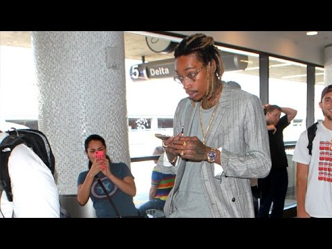 Wiz Khalifa Dresses Up To Roll Through LAX After Arrest