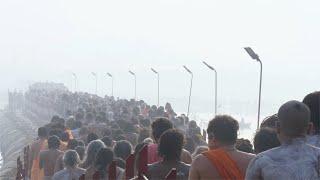 Indian crowd crossing pontoon bridge over the river Ganga at the Kumbh Mela 2019