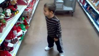 Zach dancing in Walmart to the xmas singing hats