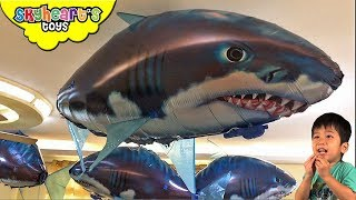FLYING SHARKS inside our house! Skyheart Toys plays with air swimmer balloons for kids