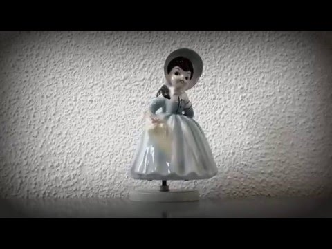 Wind-up porcelain music box doll (not creepy at all)